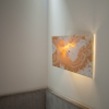 Longhouse Sconce – clear coated steel frame & amber onyx stone shade