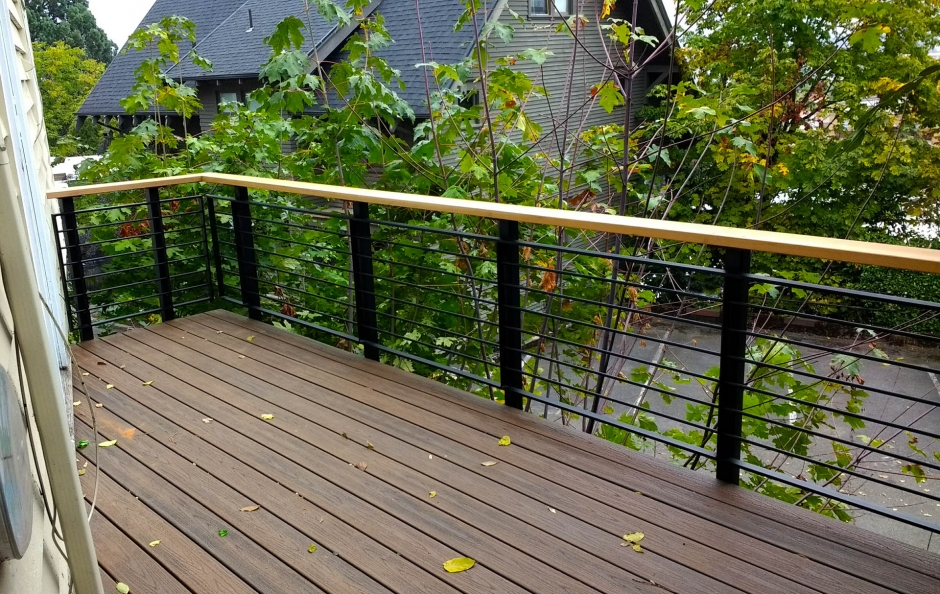 Custom Designed and Fabricated Metal & Wood Railing System.