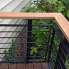 Custom Railing: powder coated steel supports w/ 1/2″ solid rod & red cedar handrail
