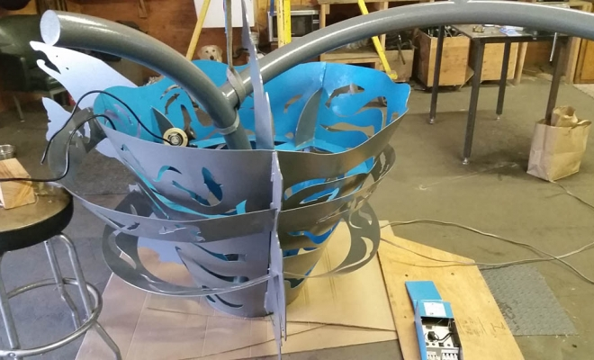 """Back from the powder coater with a fresh wrinkled """"tree bark-ish"""" finish. We are in process of hand painting select areas to accent internal lighting , which will be installing as low energy low voltage LED lighting connected on site once installed."""