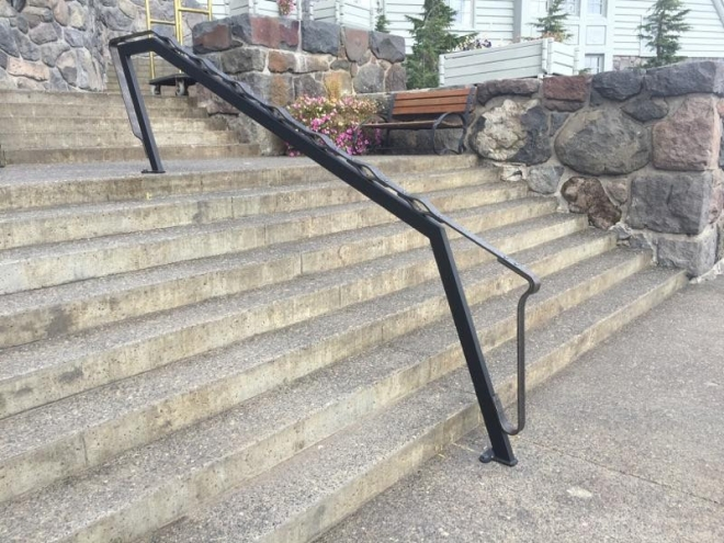Leaning toward the main entrance, new handrails for Timberline Lodge are ready for winter.